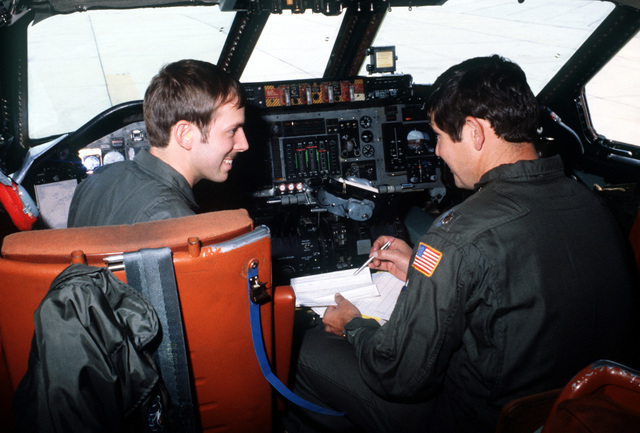 LT. Ted Truex and MAJ Charles Robinson, C-141 Starlifter aircraft pilots, make a final check on the aircraft instrument panel before takeoff during exercise Team Spirit (Coronet Spray)