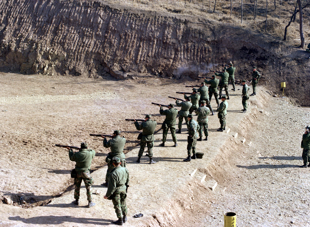 Marine Corps personnel from Marine Aircraft Group 12 (MAG-12) practice shotgun shooting during exercise Team Spirit '81