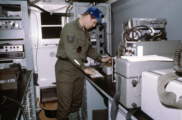 MSGT Lawrence L. Oien performs equipment maintenance during exercise Team Spirit '81. The airman is a member of the 107th Tactical Control Squadron, Air National Guard