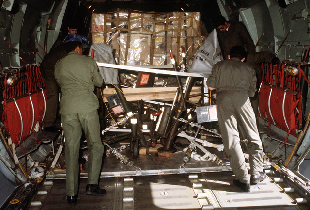 Personnel load a pallet of cargo aboard a C-141 Starlifter aircraft during exercise Team Spirit (Coronet Spray)