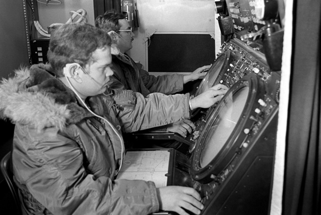 Radar operators monitor radar scopes at a Falcon radar site. The operators are from the 604th Direct Air Support Squadron, involved in Exercise Team Spirit '81
