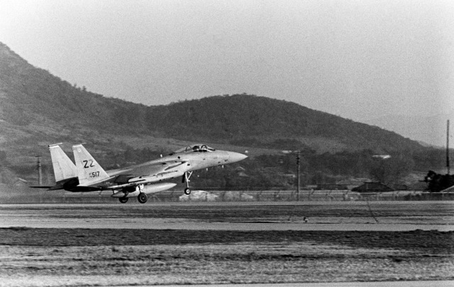 Right side view of an F-15 Eagle aircraft taking off. The aircraft is assigned to the 18th Tactical Fighter Wing, involved in exercise Team Spirit '81