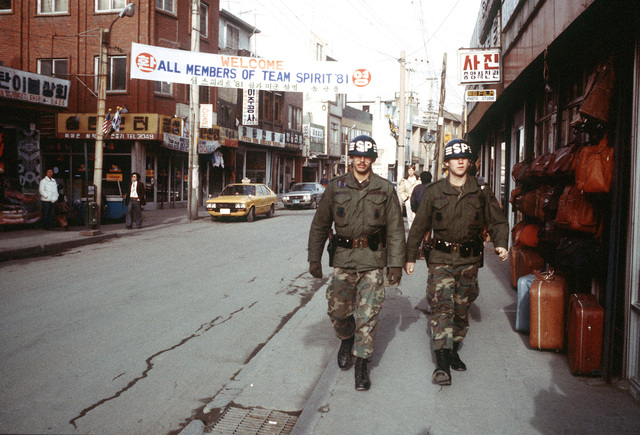 Security policemen patrol a street of Son Tan Up during exercise Team Spirit '81