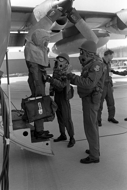 Security policemen, wearing chemical warfare gear, undergo base defense training, part of exercise Team Spirit '81