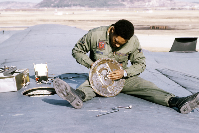 SGT Earl E. Griffin works on an AC-130H Hercules aircraft wing access panel. The airman is a 1ST Special Operations Wing member involved in exercise Team Spirit '81