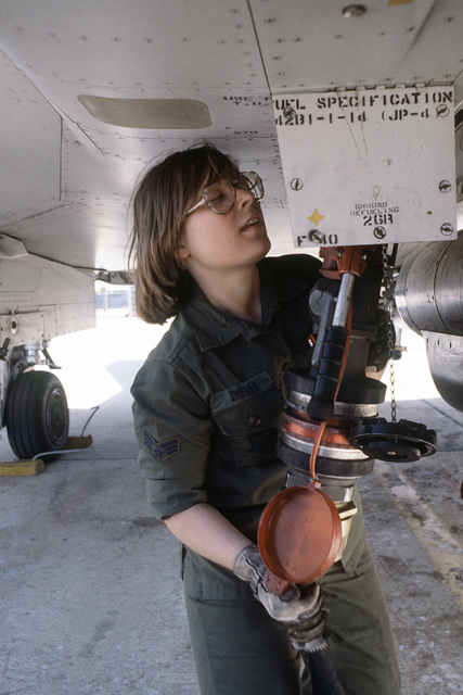 SGT Valerie M. Dierics attaches a hose to an aircraft for refueling during exercise Team Spirit '81