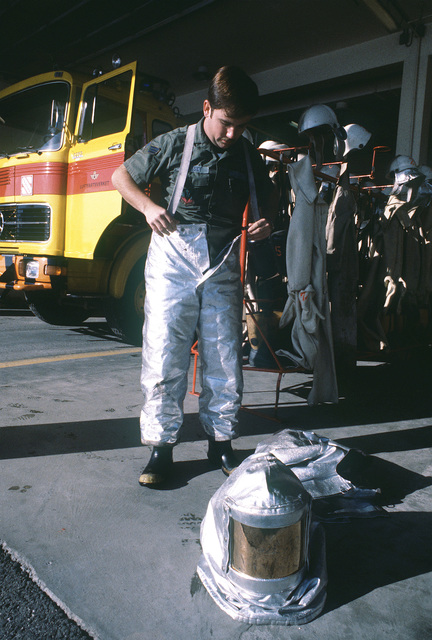 SRA Jim Comisky, 56th Civil Engineering Squadron, works at the Flesland airport fire department during Operation Coronet Falcon. Comisky is making comparisons between the American and the Norwegian type firefighting suits
