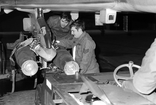 SSGT Anderson and Loading Crew Supervisor, SSGT Ron Lowery, left to right, load GBU-12 laser guided bombs on an F-4 Phantom II aircraft