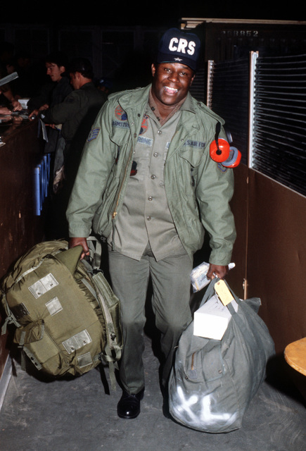 SSGT Jimmy Armstrong carries his luggage during final preparations for exercise Team Spirit (Coronet Spray)