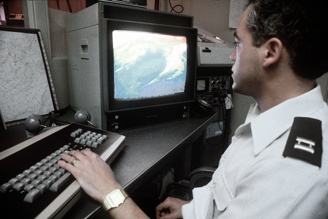 CPT Geisler, United States Air Force, performs weather prediction experiments at the Man Computer Interactive Data Acquisition System (MCIDAS)