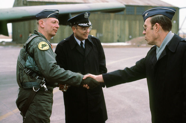 BGEN Paul A. Schempp, commander, 174th Tactical Fighter Wing, shakes hands with fellow participants in exercise Coronet Sail