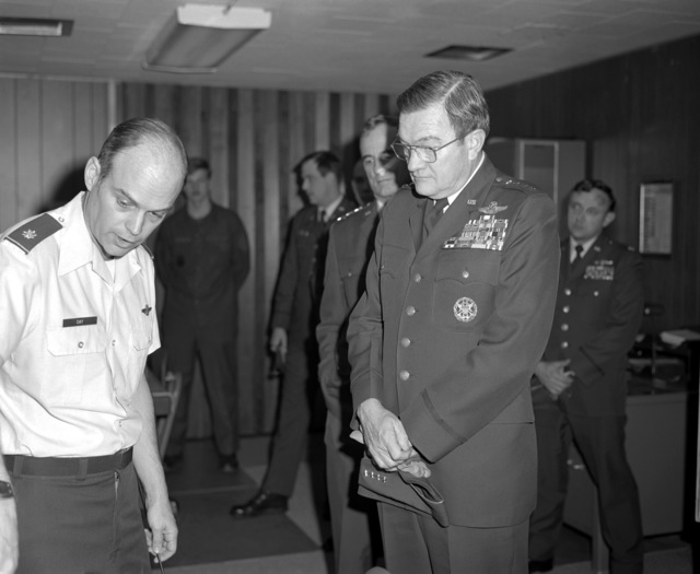 During GEN Robert C. Mathis' tour of the base, MAJ Day, of the Yukon Bomb Range, gives him a short briefing