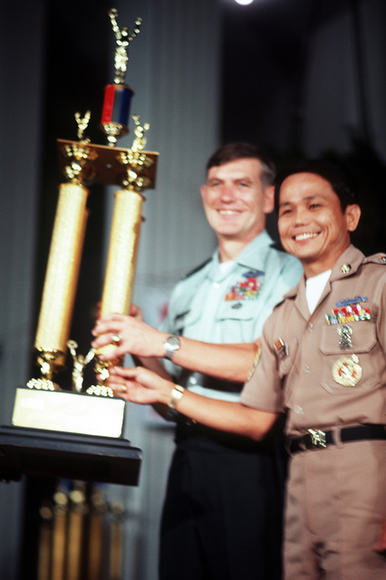 SFC Benigno Pineda, winner of the outstanding soldier in the Philippines, poses with his trophy. With him is BGEN James Foss. The award took place at the annual USO SIx-Star Salute at the U.S. Embassy