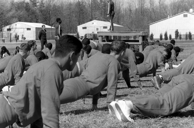 ROTC midshipmen do push-ups during a physical training period at the Officer Candidate School