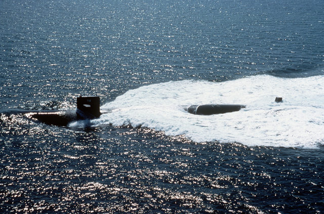 An aerial port beam view of the nuclear-powered attack submarine SAN FRANCISCO (SSN-711) underway during sea trails held about one month before commissioning. The ship was built by Newport News Shipbuilding