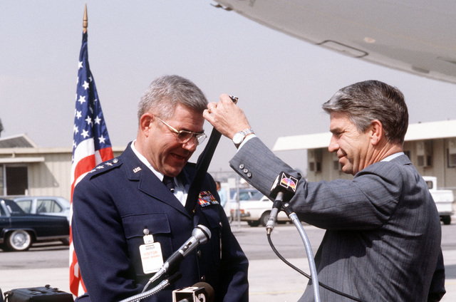 The U.S. Air Force accepts the first KC-10A Extender advanced tanker/cargo aircraft in a traditional ceremony during which McDonnell Douglas Corp. President John C. Brizendine cuts off the tie of LGEN Edgar S. Harris Jr., 8th Air Force commander