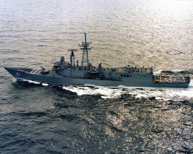 Aerial port beam view of the Oliver Hazard Perry class guided missile frigate USS FLATLEY (FFG 21) underway during acceptance trials