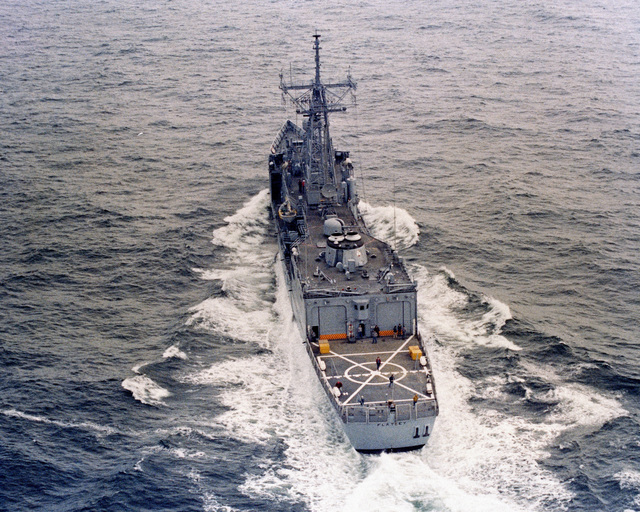 Aerial port quarter view of the Oliver Hazard Perry class guided missile frigate USS FLATLEY (FFG 21) underway during acceptance trials