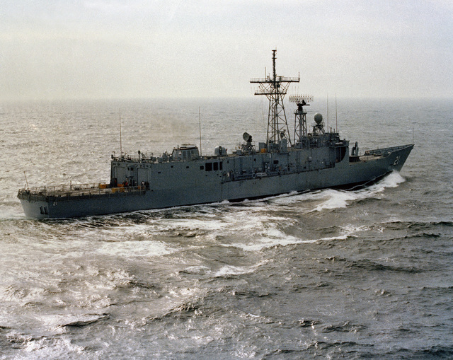 Aerial starboard quarter view of the Oliver Hazard Perry class guided missile frigate USS FLATLEY (FFG 21) underway during acceptance trials