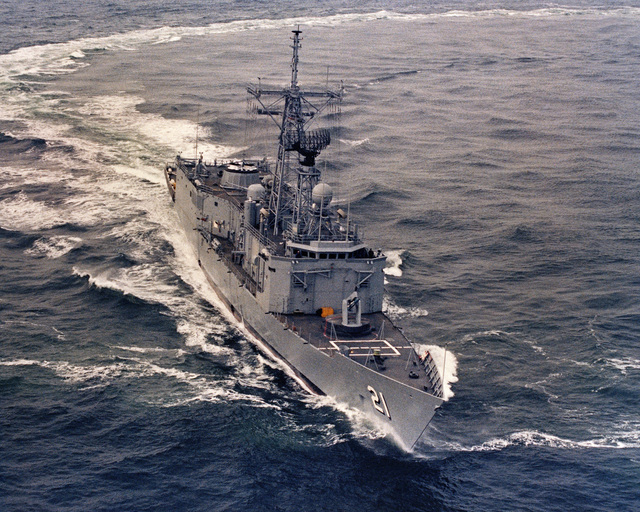 An aerial starboard bow view of the Oliver Hazard Perry class guided missile frigate USS FLATLEY (FFG 21) underway during acceptance trials