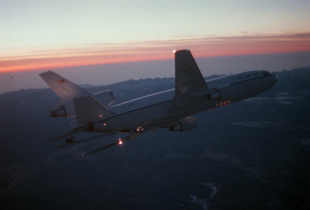 AN air-to-air right rear view of a KC-10A Extender aircraft banking to the left