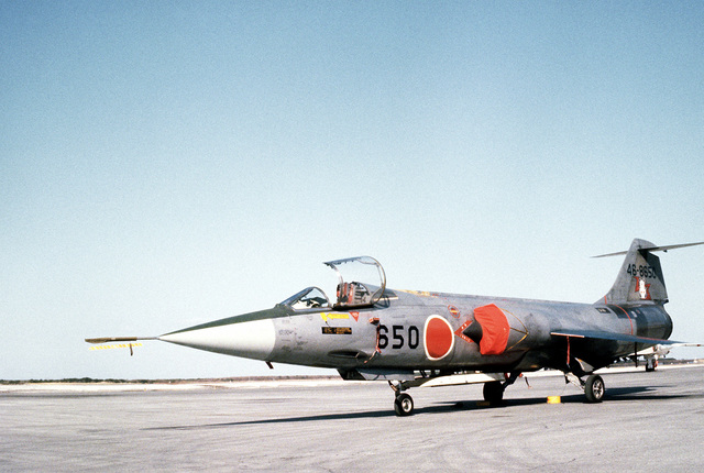 A left front view of a parked Japan Air Self Defense Force (JASDF) F-104J Starfighter aircraft. The aircraft is being used in exercise Cope North '81