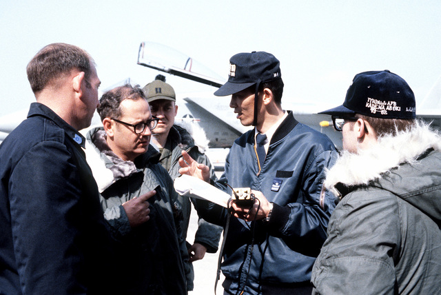 U.S. Air Force and Japan Air Self Defense Force personnel discuss F-15 Eagle aircraft ground support requirements during exercise Cope North '81