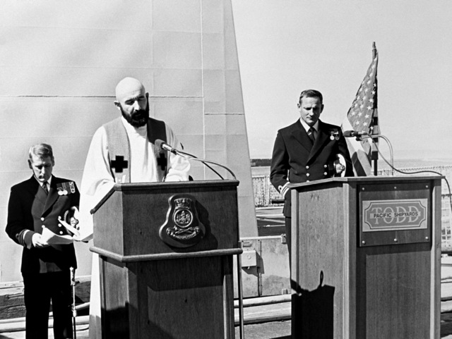 Chaplain (Cmdr.) Keely, USN, gives an invocation at the commissioning ceremony for the Australian frigate HMAS CANBERRA (F-02) at Todd Pacific Shipyards Corporation