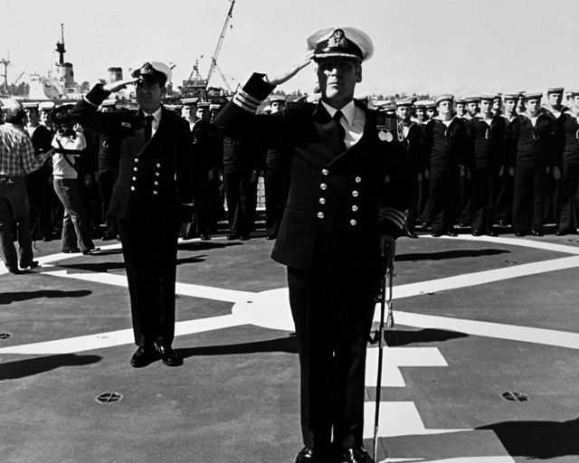 CMDR B. Wilson, commanding officer of the Australian frigate HMAS CANBERRA (F-02), salutes during the ship's commissioning ceremony at Todd Pacific Shipyards Corporation