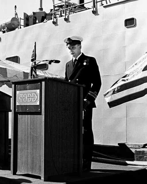 LCDR R. A. Christie, executive officer of the Australian frigate HMAS CANBERRA (F-02), speaks during the ship's commissioning ceremony at Todd Pacific Shipyards Corporation