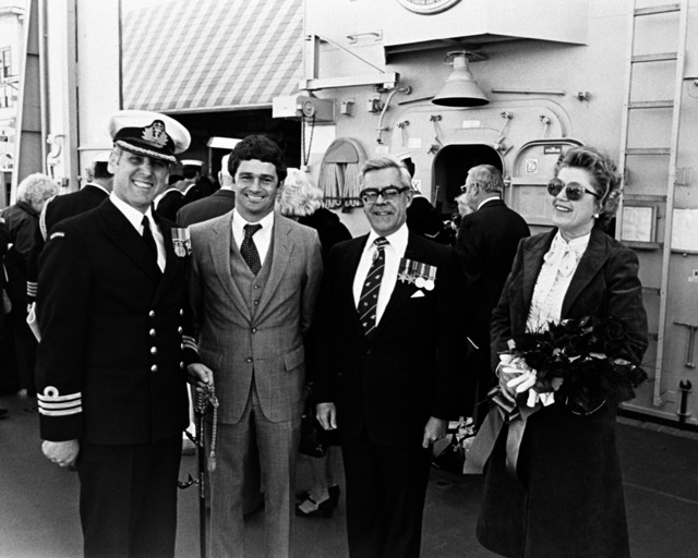 Left to right, CMDR B. Wilson of the Royal Australian Navy, J.T. Gilbride Jr., and Sir Nicholas and Lady Parkinson during the commissioning ceremony for the Australian frigate HMAS CANBERRA (F-02) at Todd Pacific Shipyards Corporation