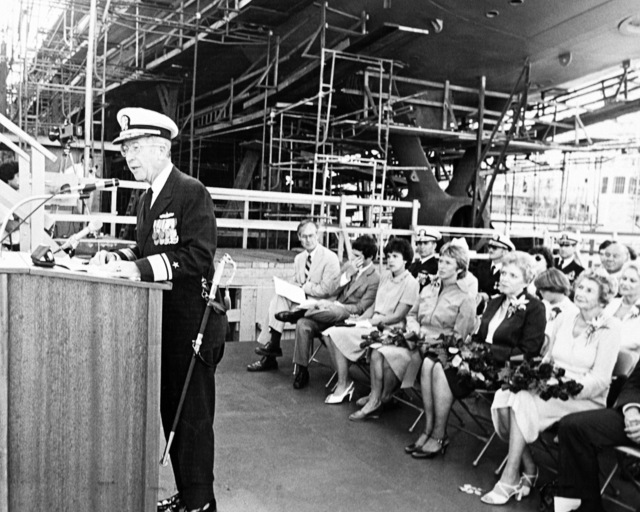 Rear Admiral John D. Beecher, deputy commander for Surface combatant Ships, speaks during the launching ceremony for the guided missile frigate CROMMELIN (FFG 37) taking place at Todd Pacific Shipyards Corporation