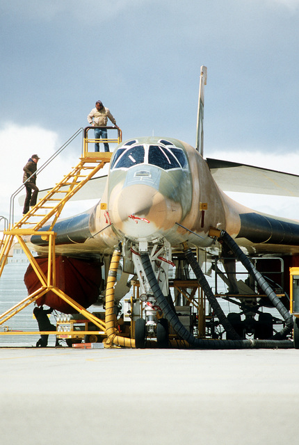 A close-up front view of a B-1 bomber undergoing electronics cooling maintenance during testing and evaluation of the aircraft