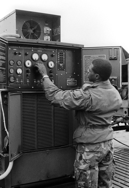 CPL John Dunbar of Marine Air Traffic Control Squadron 18, Detachment A, adjusts an auxiliary power generator. Equipment in the squadron is constantly checked to make sure that it is always in good working condition