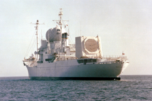 A starboard quarter view of the missile range instrumentation ship USNS OBSERVATION ISLAND (T-AGM-23) underway during exercise Cobra Judy, an exercise to test the ship's seaworthiness. OBSERVATION ISLAND, which has been undergoing modifications, is now equipped with a phased-array radar turret on its stern