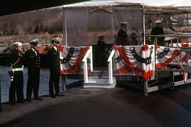 Commissioning ceremonies take place aboard the nuclear-powered attack submarine USS BREMERTON (SSN-698) with guest speakers on the speakers platform