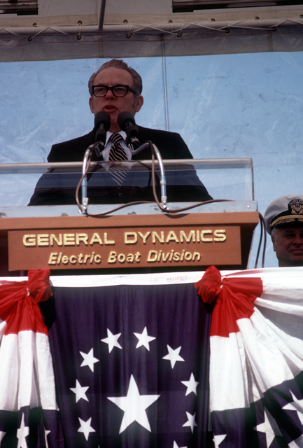 General Dynamics Executive Vice President-Marine, P. Takis-Veliotis, speaks at the commissioning ceremonies for the nuclear-powered attack submarines USS BREMERTON (SSN-698)
