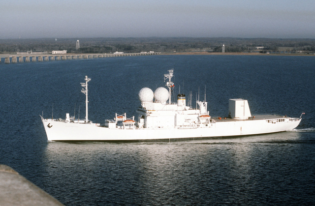 Port side view of the missile range instrumentation ship USNS OBSERVATION ISLAND (T-AGM-23) underway near the Bay Bridge during Cobra Judy, an exercise to test the ship's seaworthiness. OBSERVATION ISLAND, which has been undergoing modifications, is now equipped with a phased-array radar turret on its stern