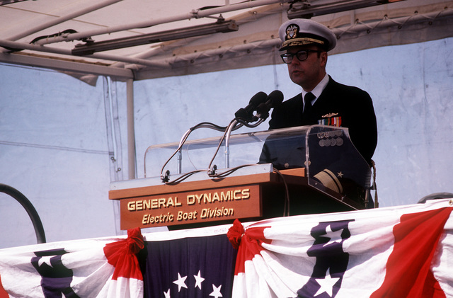 RADM Carl A. Brettschneider speaks at the commissioning ceremonies for the nuclear-powered attack submarine USS BREMERTON (SSN-698)