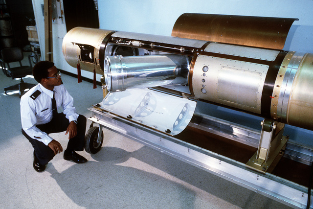 1LT Charles Bailey, missile system engineer, checks a Zodiacal Infrared Program (ZIP) II payload missile for clearance as the missile opens its excess panel to extend the sensors and cables in the Air Force Geophysics Laboratory (AFGL)