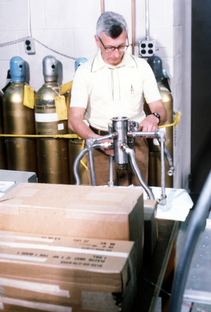 Charles Forsberg assembles an air sampler in the Air Force Geophysics Laboratory (AFGL), which will be taken to the upper atmosphere by a stratospheric gondola