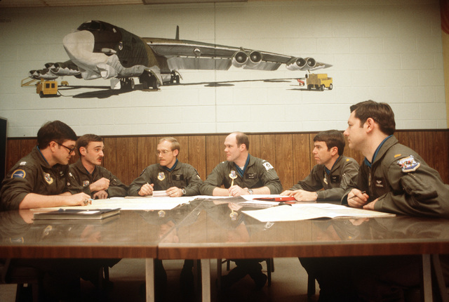 A B-52 Stratofortress aircraft pilots hold a preflight briefing for an alert mission