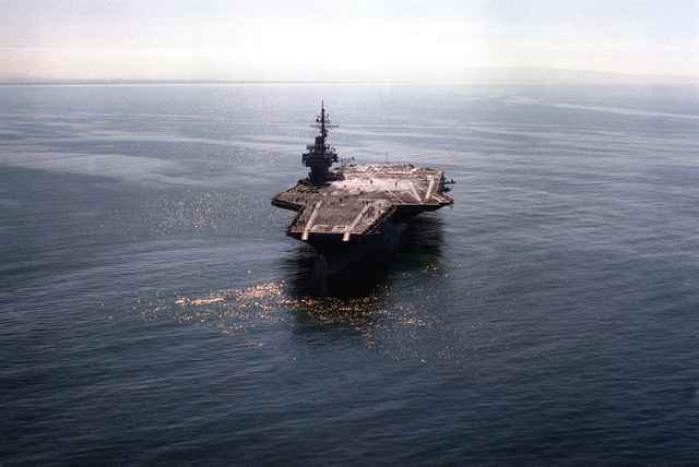 """A bow view of the USS KITTY HAWK (CV-63) as crewmen form the number """"200,000"""" on the flight deck. AN S-3A Viking has just made the 200,000th aircraft landing aboard the aircraft carrier"""