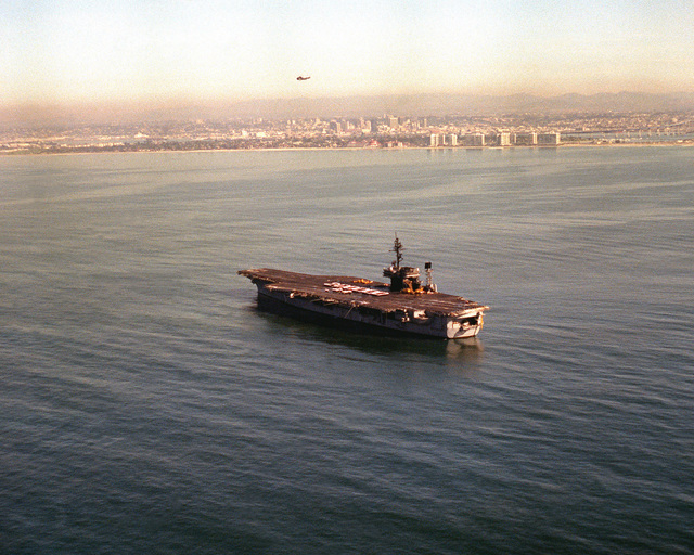 """A port quarter view of the USS KITTY HAWK (CV-63) as crewmen form the number """"200,000"""" on the flight deck. AN S-3A Viking has just made the 200,000th aircraft landing aboard the aircraft carrier"""