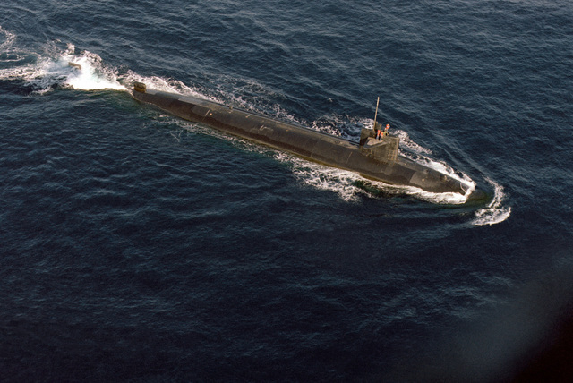 A starboard bow view of a nuclear-powered submarine underway