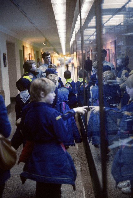 An airman guides visiting Cub Scouts throughout Air Force exhibitions in the Pentagon
