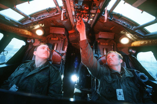 Assistant crew chief A1C Dick LaFuze and crew SRA Jeffrey S. Ryan, left to right, perform a preflight inspection of a B-52 Stratofortress aircraft instruments panel