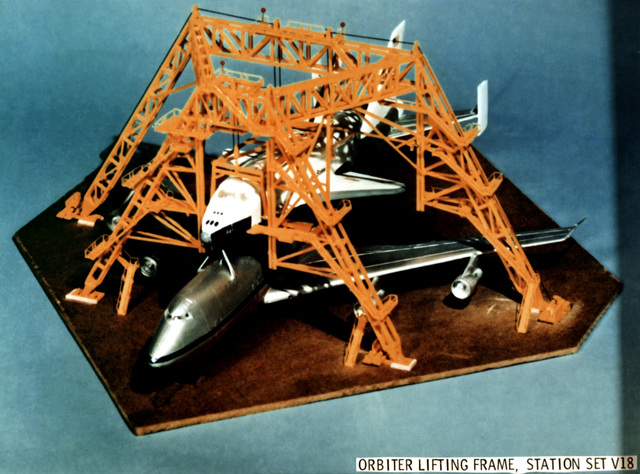 A scale model of a space shuttle orbiter lifting frame