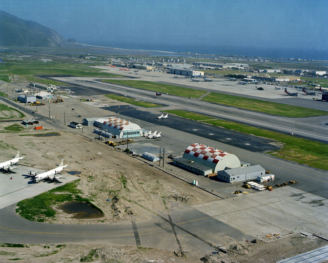 An aerial view of the Naval Air Reserve Unit (NARU) and Patrol Squadron 65 (VP-65) building and the new Attack Squadron 305 (VA-305) and Light Attack Helicopter Squadron 5 (HAL-5) reserve units near the runways at Pacific Missile Test Center