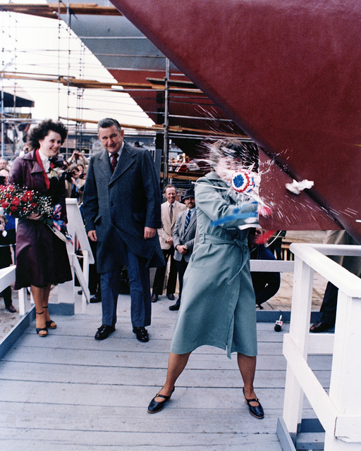 Miriam Groves Landry, sponsor's proxy, breaks a bottle of champagne across the bow of the Oliver Hazard Perry class guided missile frigate USS STEPHEN W. GROVES (FFG 29)